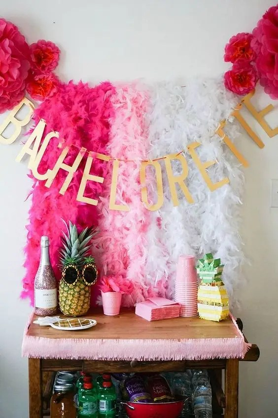 very colorful tropical-inspired champagne table with pink and fuchsia decor