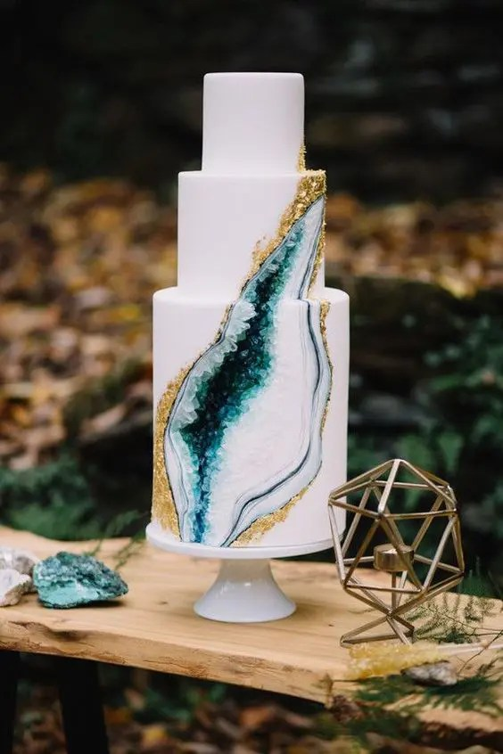 a trendy emerald and gold geode wedding cake