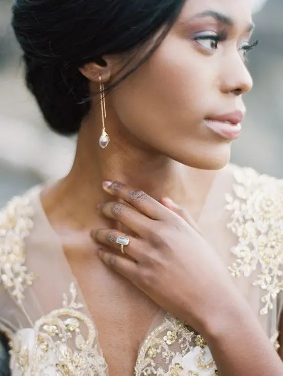 chic golden earrings with rhinestones match the ring and match the dress with gold embroidery