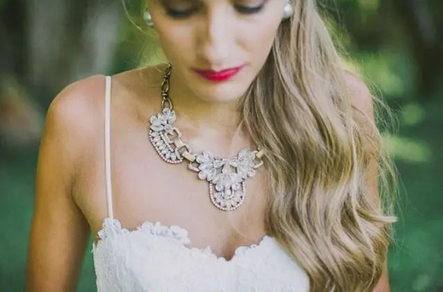 unique and pretty statement necklace accentuates the sweetheart neckline