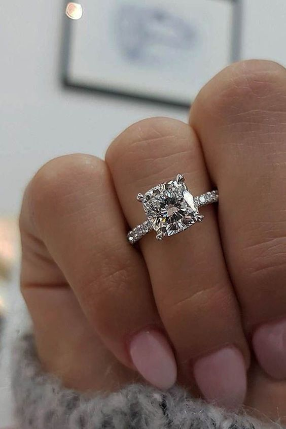 a chic cushion shaped diamond white gold engagement ring without a halo looks edgy and modern