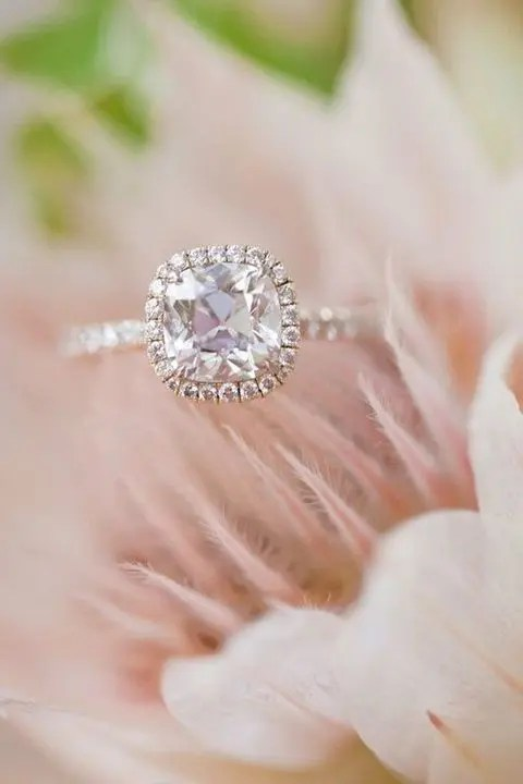 a rose gold engagement ring with a cushion pink diamond and a halo for a romantic girl