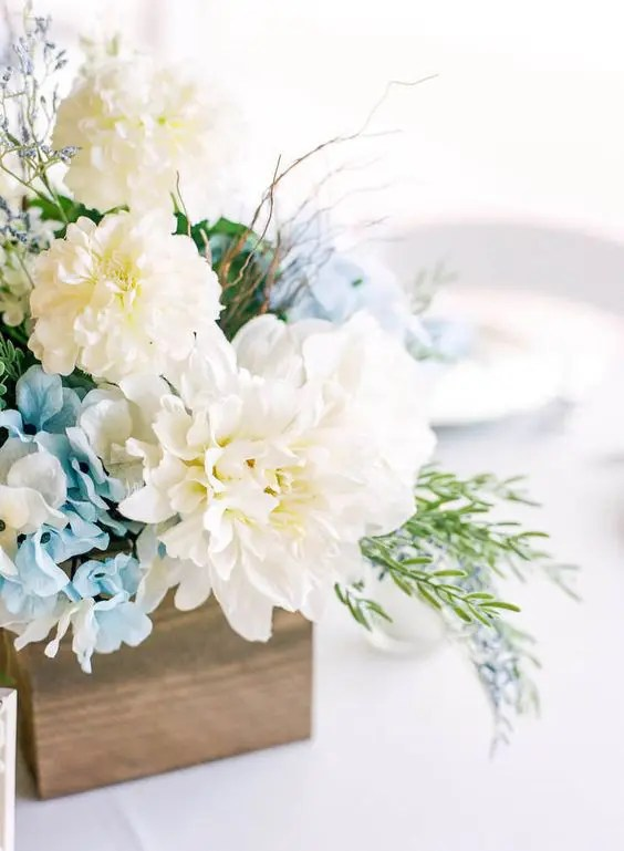 a wooden box with blue hydrngeas, white dahlias and textural greenery is ideal for a rustic wedding