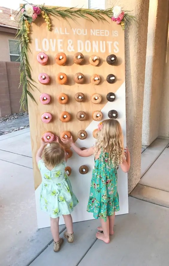 color block painted donut wall decorated with greenery and blooms