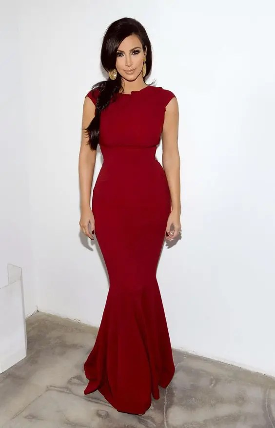 a gorgeous mermaid red sleeveless dress with a high neckline and all the curves highlighted