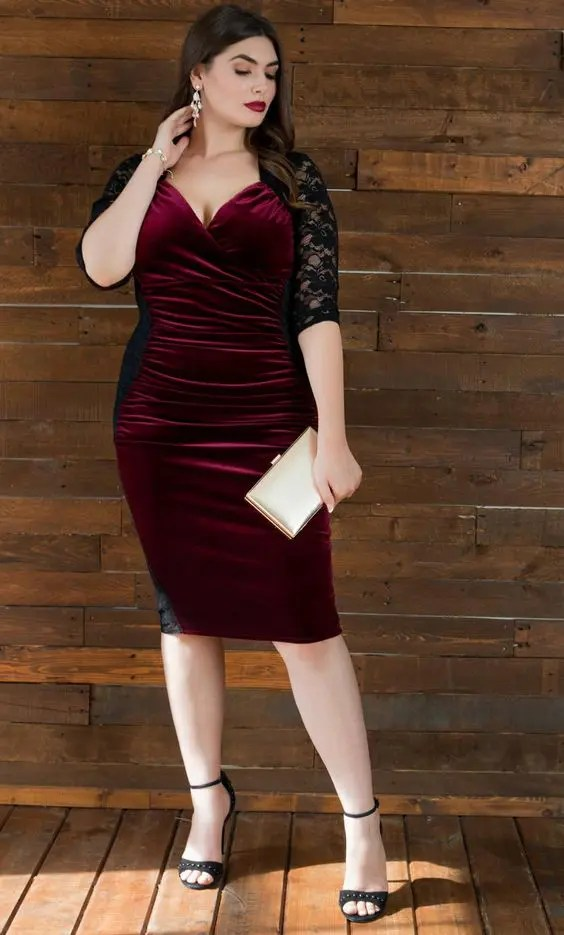 a gorgeous burgundy velvet midi dress with black lace inserts and sleeves plus black heels