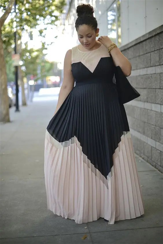 a gorgeous geometric bridesmaid's dress in blush and black with no sleeves and a high neckline looks wow