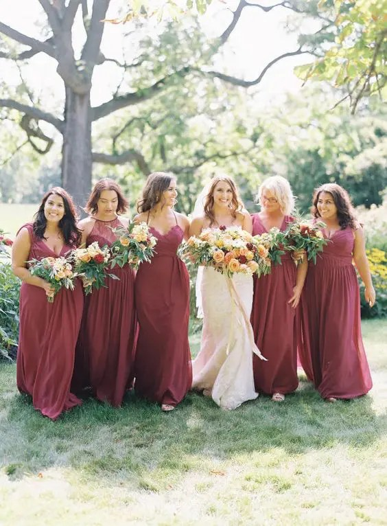gorgeous mismatched burgundy dresses with various detailing for a fall wedding