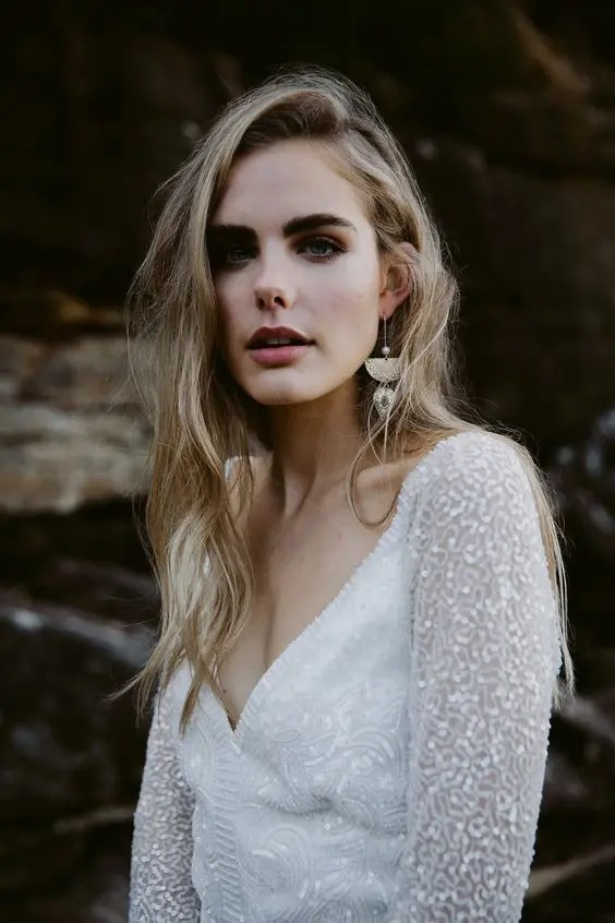 bold statement earrings with beads and geometric shapes for a modern bridal look with a boho feel