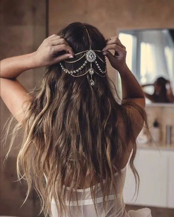 long waves down accented with a jeweled chain that looks boho and a bit gypsy-like