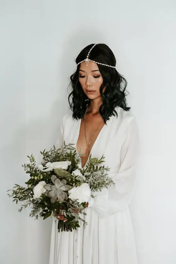 a jeweled boho chain headpiece with pearls and rhinestones for a free-spirited bride