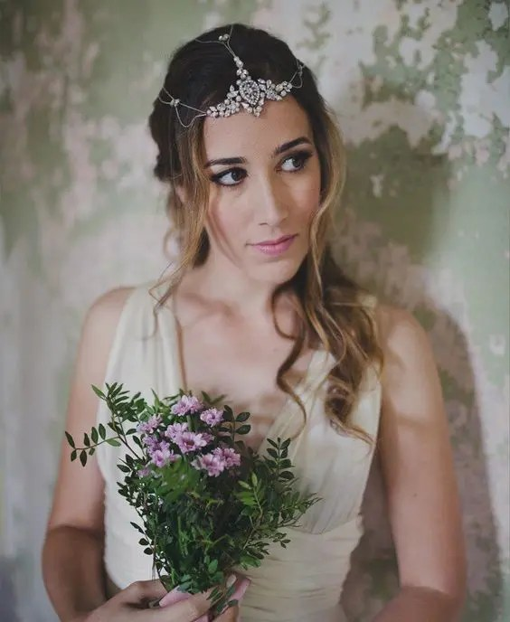 a gorgeous chain and rhinestone headpiece for a sparkly boho bridal look