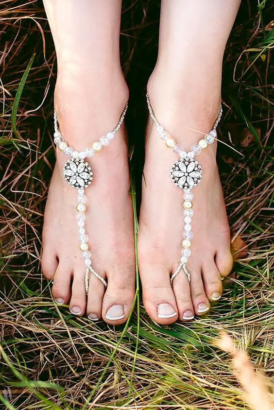 cute beach wedding sandals with pearls and beads and rhinestone flowers for a garden bride