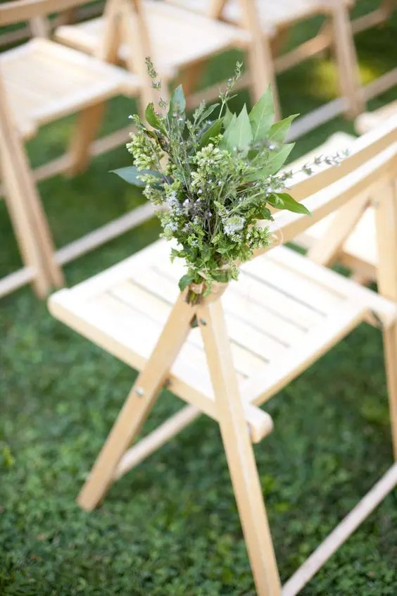 a textural greenery bouquet is a non-traditional yet very fresh and cool idea to line up the aisle