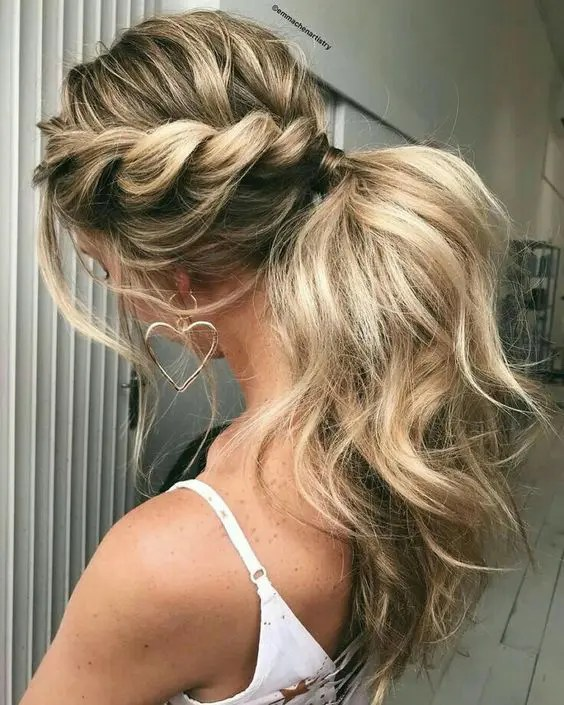 a low ponytail with two twisted braids on the sides and locks down for a simple modern look