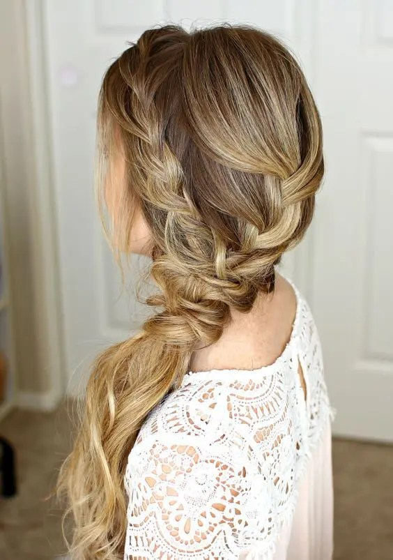 a low braided ponytail made up of several braids plus a halo is a relaxed idea for a rustic or boho wedding