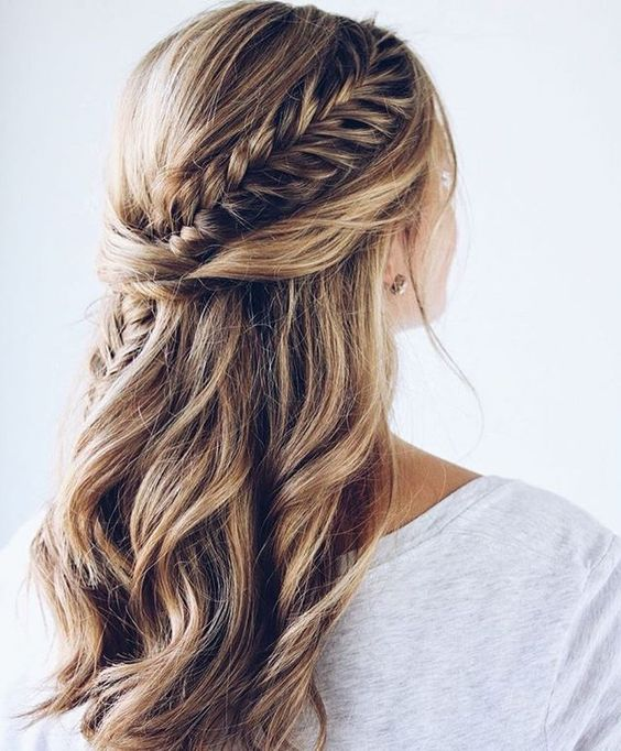 a chic half updo with waves, twists and a fishtail braid going down for a boho bridesmaid