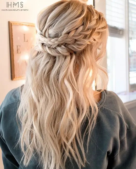 a half updo with a double braided halo and textural locks down for a boho chic bridesmaid