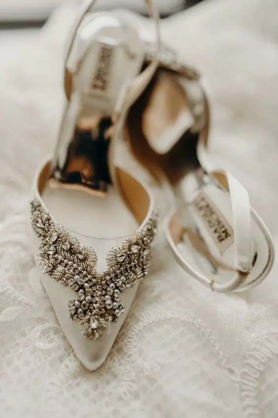off-white pointed toe heavily embellished wedding heels will add a refined touch to your look