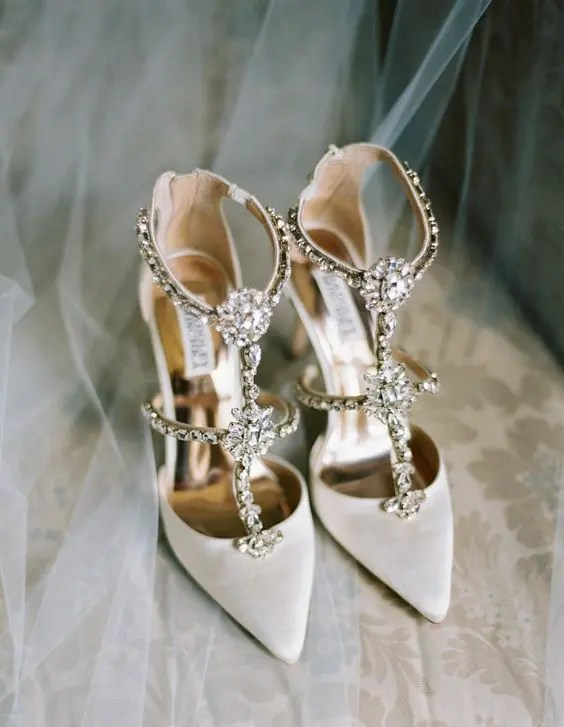 white strappy embellished wedding shoes are a bold and shiny option