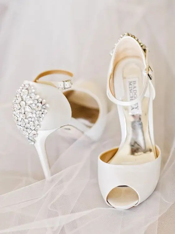 white peep toe wedding shoes with heavily embellished backs for a chic and shiny touch