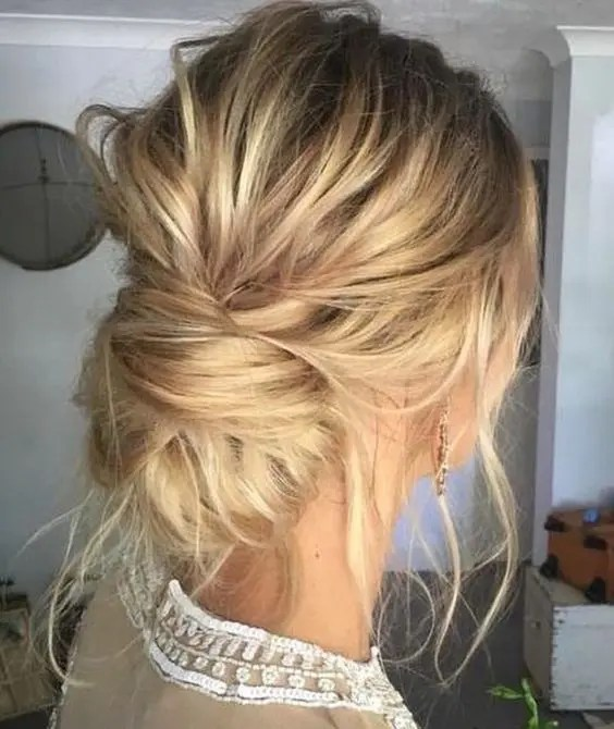 a super messy low bun with locks down and a bump is an effortlessly chic hairstyle
