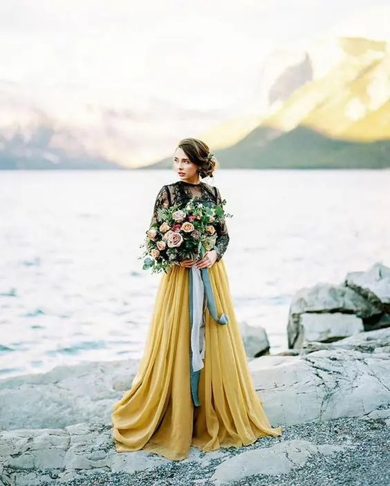 a black sheer lace bridal top and a yellow pleated skirt for a bold fall bridal look