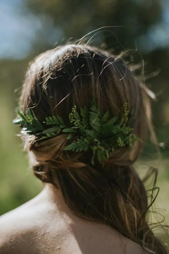 side-swept loose curls and a touch of fern are ideal for a woodland bride