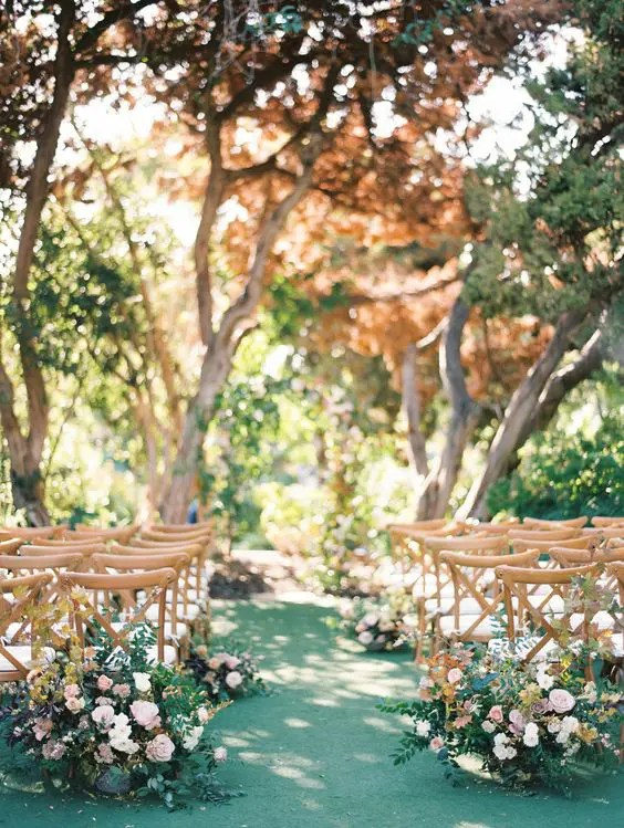 take your ceremony to a garden, so you won't need much venue decor, it will be already there