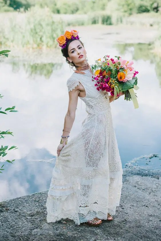 a bride wearing an upcycled wedding dress she bought at a thrift store