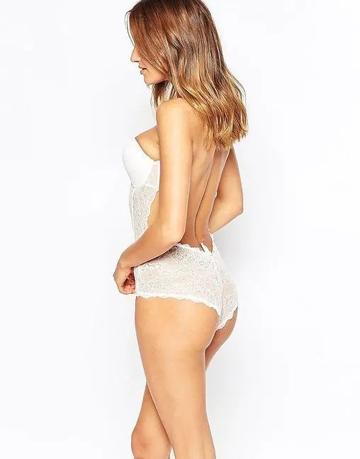 such a chic white lace bridal bodysuit is ideal for a wedding dress with a cutout back and no straps