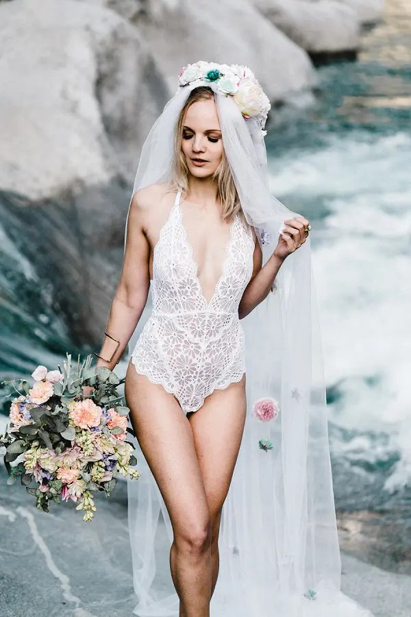a white lace plunging neckline bodysuit and a catchy floral veil can be used to make some boudoir-style shots