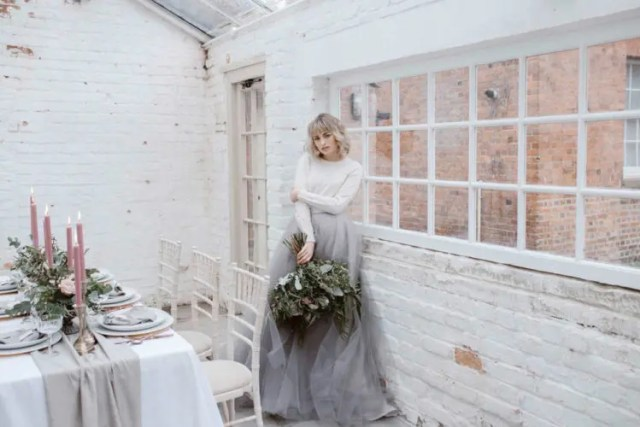 a white long sleeve top and a grey tulle A-line skirt for a modern look with a girlish feel