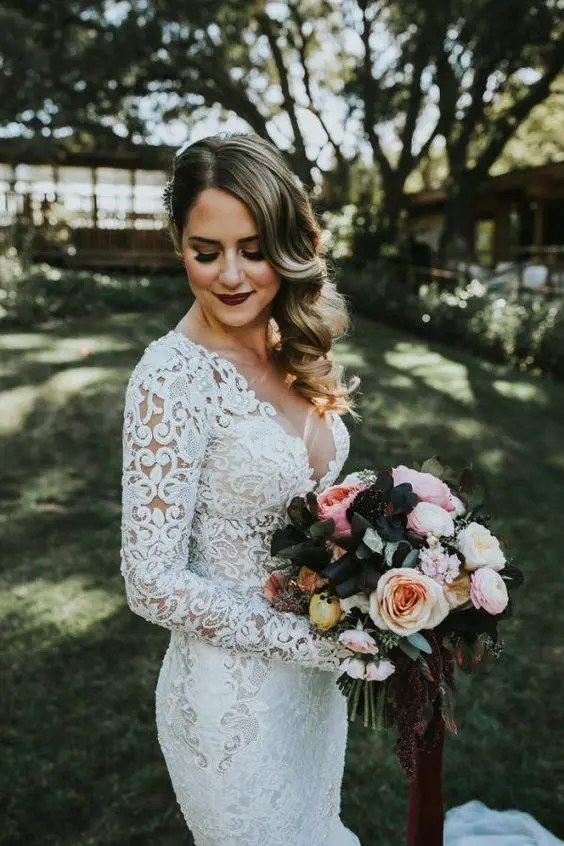 a dark burgundy lip and smokeys are a great idea for a statement bridal look in any season