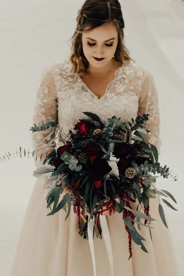 a very dark burgundy lip and subtle burgundy smokeys are a great idea for an elegant fall wedding