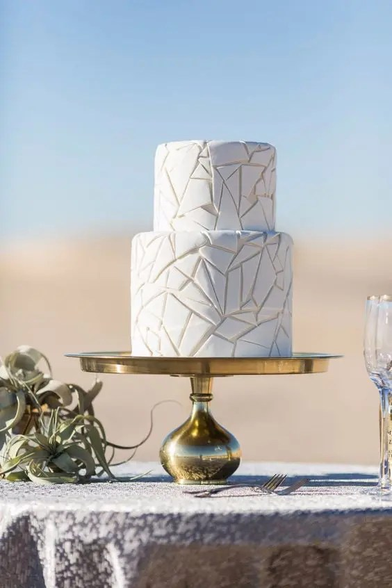 a white crackle wedding cake is a chic modern idea as geometry is one of the top trends in the wedding world