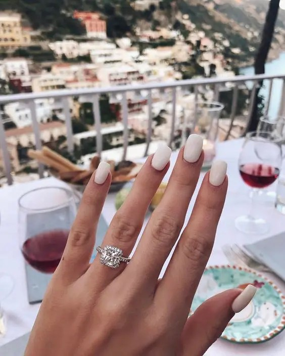 include a beautiful view of the place where you are getting engaged into your engagement ring show off