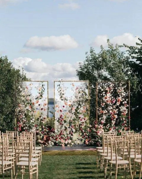 framed acrylic screens decorated with colorful blooms and greenery for a bright and luxurious wedding backdrop