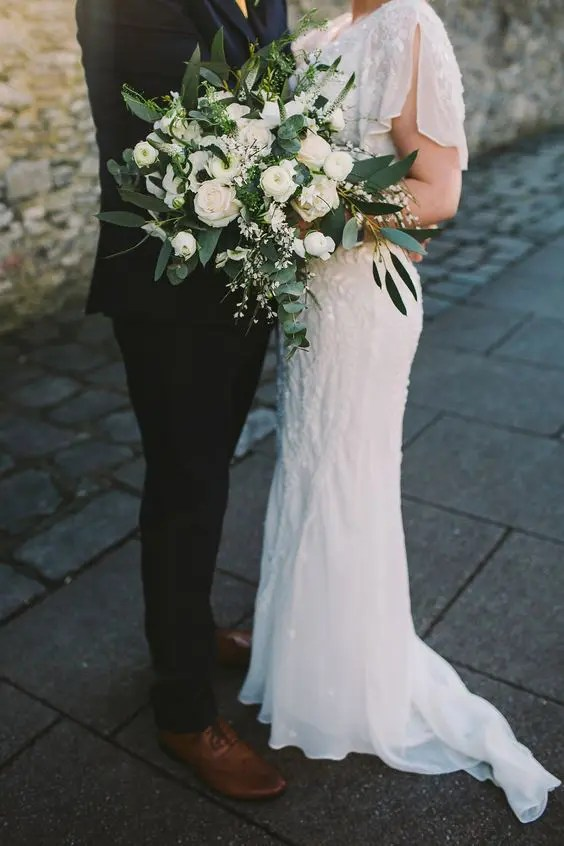 a lush white winter wedding bouquet with greenery is a chic and timeless idea for every bride