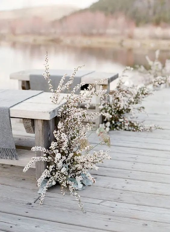 white blooms, whitewashed benches and grey covers create a real frozen look, which is very romantic for a winter wedding