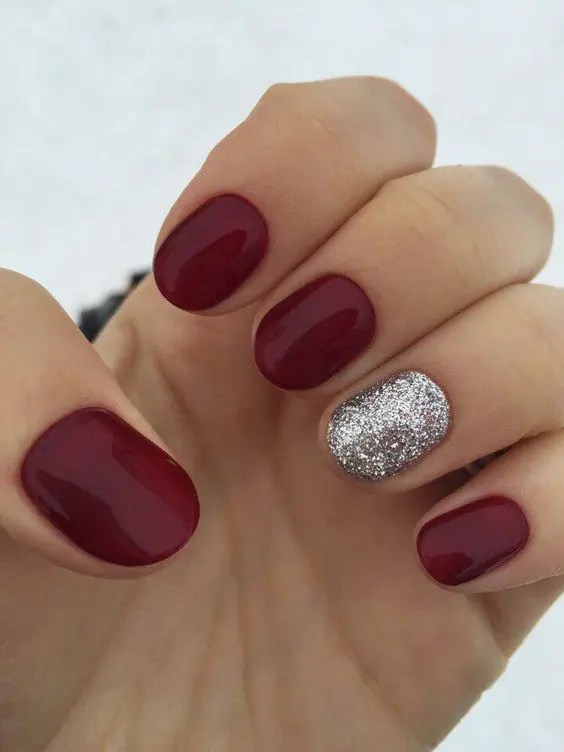 a classic red manicure spruced up with a silver glitter accent nail are perfect for Christmas