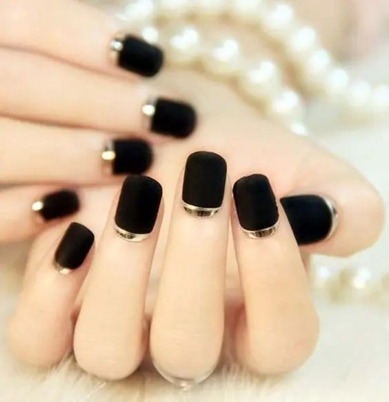 black matte nails with a touch of glitter for winter holidays wedding, so festive and so bold