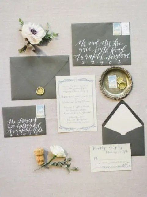 grey wedding stationery with whites and calligraphy plus touches of gold is a timelss idea for winter