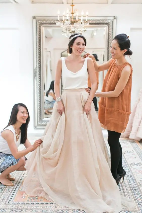 a very casual bridal separate with an off-white top and a blush layered amxi skirt for a brunch wedding