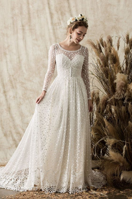 d59d1487689 a vintage-inspired polka dot wedding dress with an illusion strapless  neckline