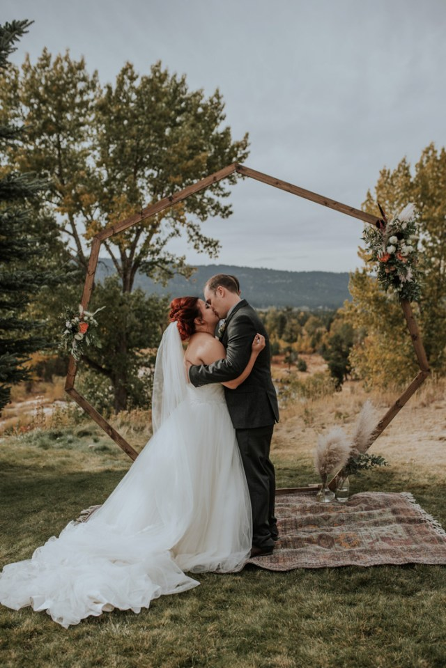 The wedding arch was a geometric one, decorated with greenery and blooms
