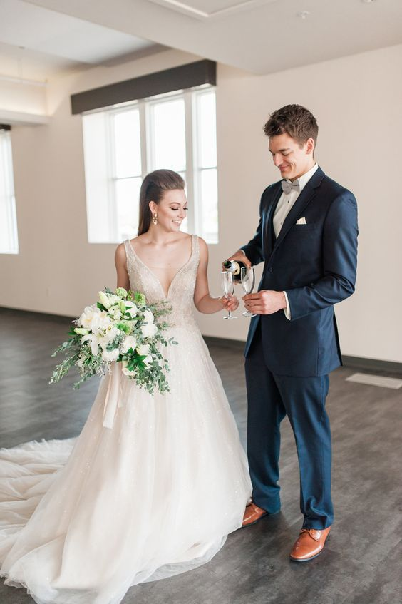 a beautiful ivory ballgown with a fully embellished bodice with a plunging neckline and a full skirt with a train