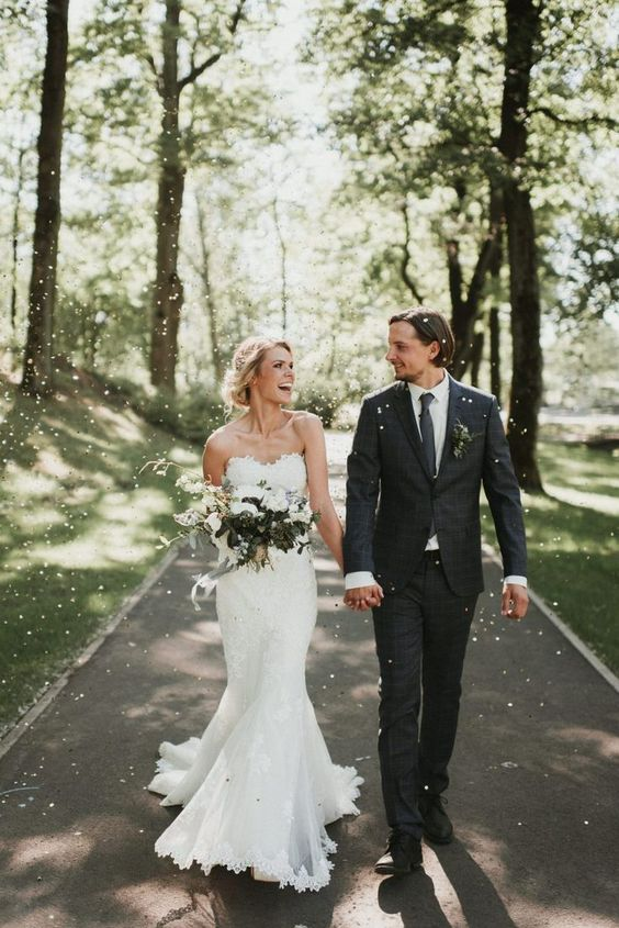 a lace strapless mermaid wedding dress with a train and a sweetheart neckline for a romantic feel