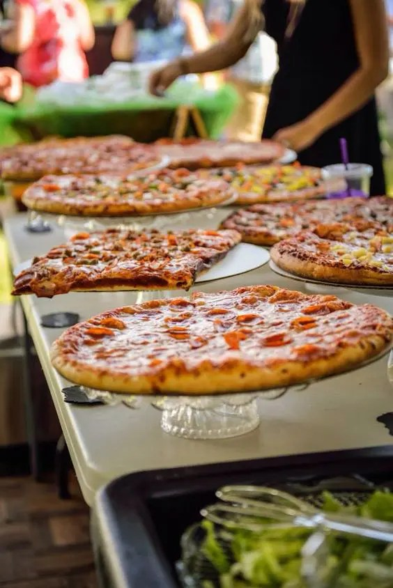 an elegant pizza buffet with crystal cake stands is a chic idea for many types of weddings