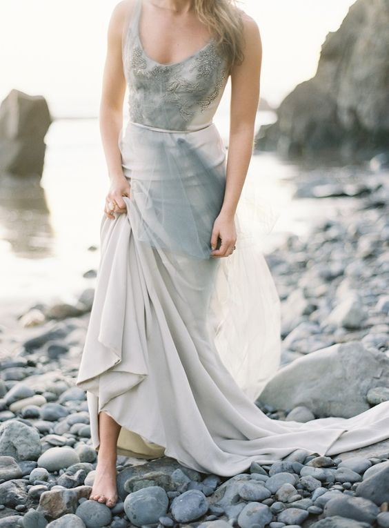 an ethereal pearly grey wedding dress with wide straps, a scoop neckline and an embellished bodice